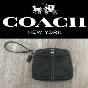 | Coach | Glossy Black Turnlock Wristlet